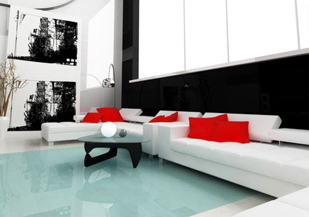 White modern sofa with red cushions